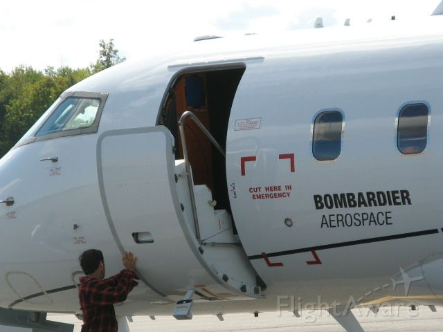Bombardier Challenger 300 (C-GJCJ) - Challenger 300 test aircraft at Fulton, NY after a test flight 9/29/07. Aircraft registered to Bombardier Inc.