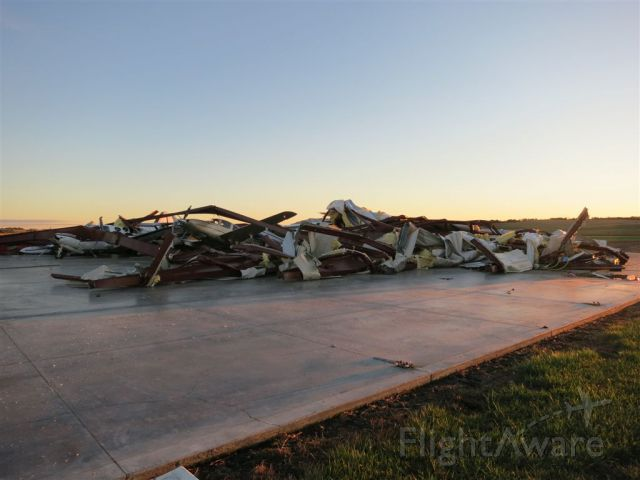 Cirrus SR-22 (N575TT) - Six aircraft and 100x100 hangar reduced to pile by EF3+ tornado.  October 2013.