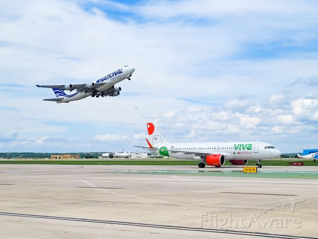 Airbus A320 — - A vivaaerobus a320 arrives from MTY while a National Cargo 747 takes off for IAH after diverting to SAT from storms