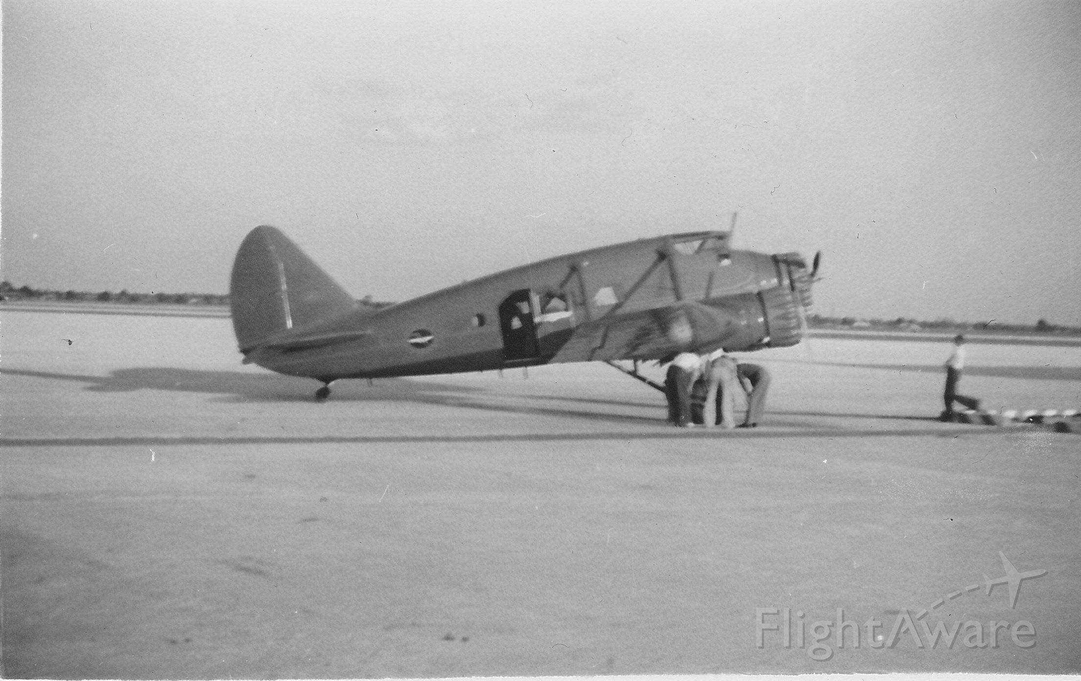 """— — - Circa April 1938, Miami Municipal Airport. """"This Stinson Model-A Trimotor was owned by some news agency."""" (Frank Gannett)"""