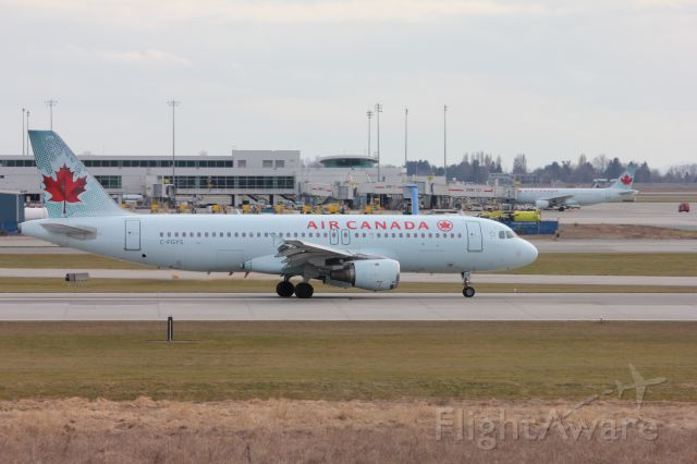 Airbus A320 (C-FGYS) - Spotting by 26R/08L. An Air Canada A320 slowing down on 26R.