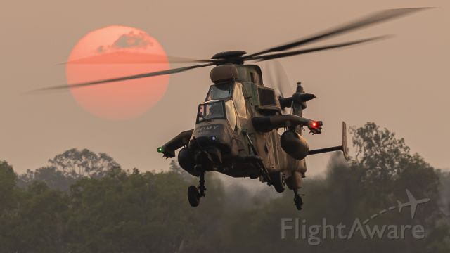 Eurocopter EC-635 (A38022) - Eurocopter Tiger Armed Reconnaissance Helicopter of 1st Aviation Regiment takes off into a bushfire sky with the smoke taming the setting sun.