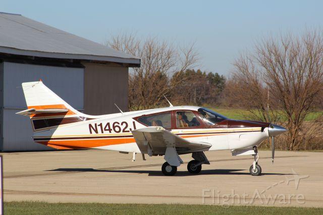 Rockwell Commander 114 (N1462J) - Nice little Rockwell Commander 112A, seen outside the hangar on 28 Nov. 2020.<br />Gary C. Orlando Photo
