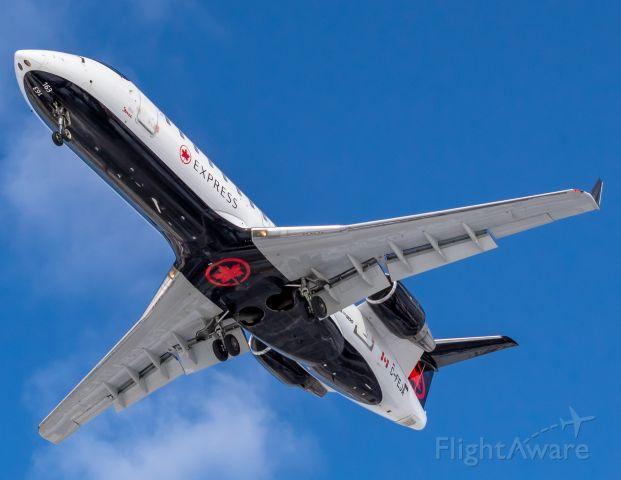 Canadair Regional Jet CRJ-200 (C-FEJA) - A Jazz Air CRJ-200 overhead to land at Montreal.