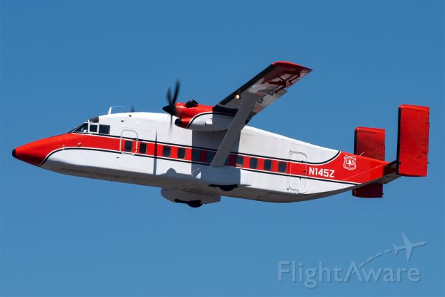 Short 330 (N145Z) - JUMPR45, belonging to the USFS, departs Redmond during a local training flight. This ex Air National Guard Sherpa is now used as a smokejumper aircraft. The aircraft will insert specially trained firefighters by parachute to provide an initial attack response.