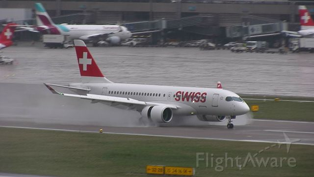 Bombardier CS100 (HB-JCA) - Arriving in the wet!!! Check out the thrust reversers!!