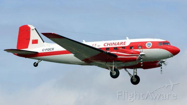 Douglas DC-3 (turbine) (C-FGCX) - 13R approach.