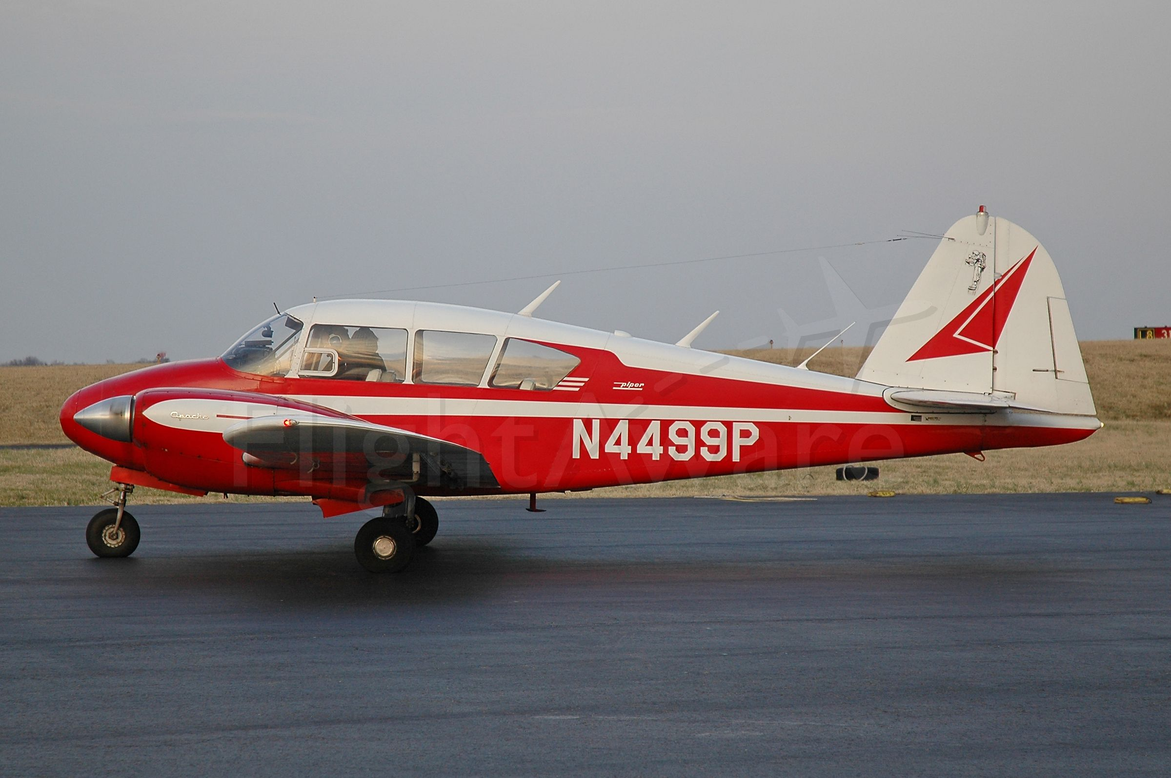 Piper Apache (N4499P) - Taxing out from Signature Flight Support.