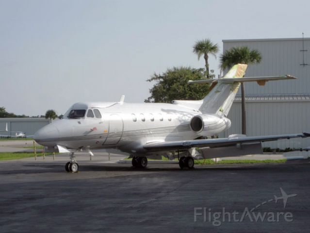Hawker Siddeley HS-125-400 (N42AS) - A 1968 model Hawker jet retrofitted with Garrett turbofan engines. Almost 2x the range as the old Viper engines. Note the ground flaps full extended. Raw photo courtesy of LEARJETMIAMI - thank you!