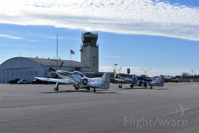 North American P-51 Mustang — - Two P-51s on the ramp