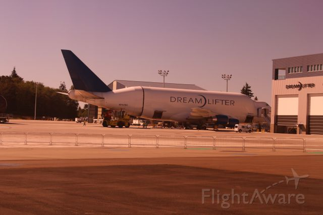— — - Boeing Dreamlifter unloading at Paine Field, Thurs 9/11/14. I had to take the photo through a tinted window. Sorry about the color.