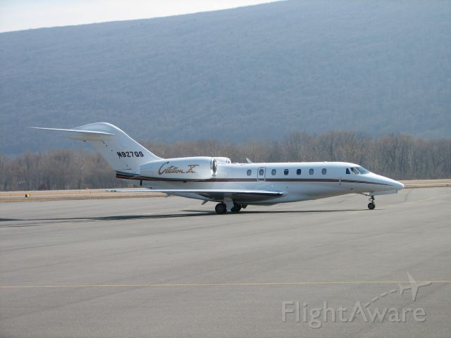 Cessna Citation X (N927QS) - Waiting patiently on the GA Ramp.