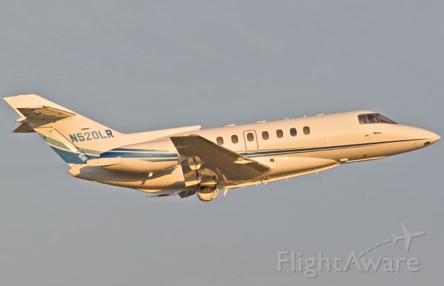 Raytheon Hawker 800 (N520LR) - New paint job close up and climbing off RWY22R