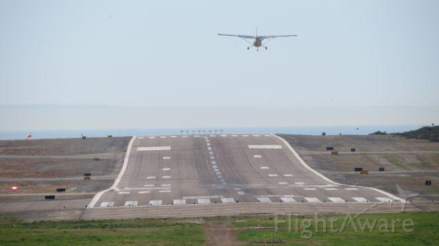 — — - Looking down runway 24 at KCRQ.