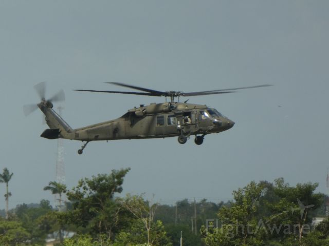 — — - Army Blackhawk at Philip SW Goldson International Airport in Belize
