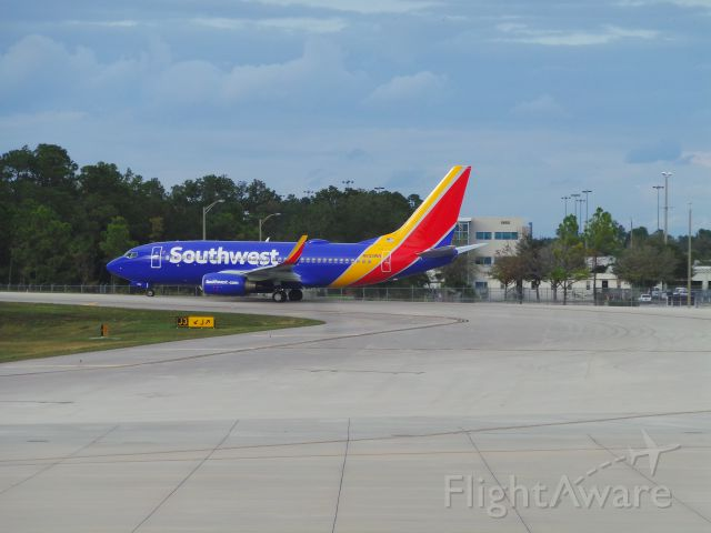 Boeing 737-700 (N933WN) - Southwest 3723 taxiing for takeoff from MCO to MSY