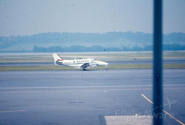 Beechcraft Airliner (N135HA) - Beach 99 of Henson Airways (Allegheny Commuter) taxis at KDCA Circa 1965-70