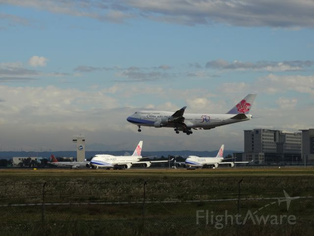Boeing 747-400 (B-18208) - B-18208, B-18207, and B-18715, respectively.