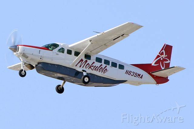Cessna Caravan (N839MA) - Takes off. Seems like the first photo of this aircraft in the database.