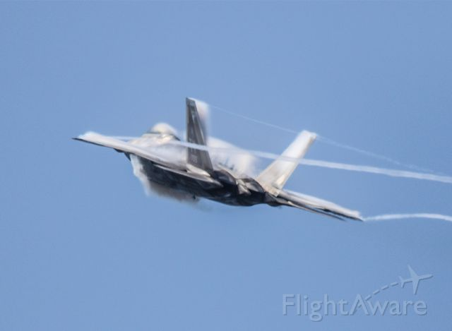 Lockheed F-22 Raptor — - Vapor cloud forming around the F-22 as it activates the afterburners. Thank goodness for the Canon 800mm lens!