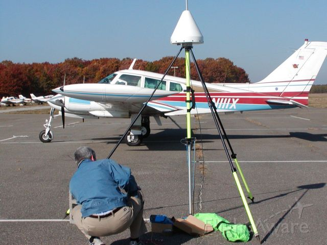 Cessna 310 (N111X) - GPS ground station with N111X in the background. Aircraft used for aerial survey of any surface and bathemetry using the EAARL system.