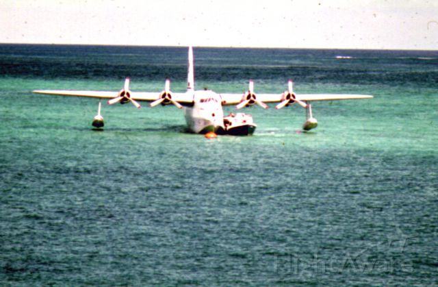 — — - Sunderland/Sandringham (conversion) in the lagoon at Lord Howe Island (c1971). Photo taken from the shore as the craft was exactly balanced with both pontoons clear of the water on a perfectly calm day. (Sorry about the photo quality - it has been restored from a very small transparency.) Flying boat operations to Lord Howe ceased in 1974.