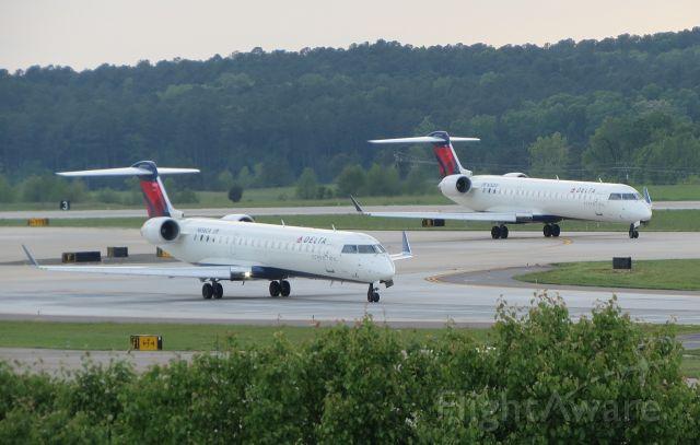 Canadair Regional Jet CRJ-700 (N656CA) - Drag race to see who departs first.. N752EV in the background