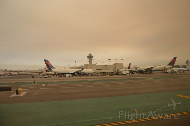 Airbus A330-200 — - Hazy sky over busy morning LAX traffic