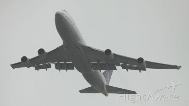 Boeing 747-200 (N118UA) - Fog Shrouded departure over San Bruno, Ca to PEK, 04-28-2015