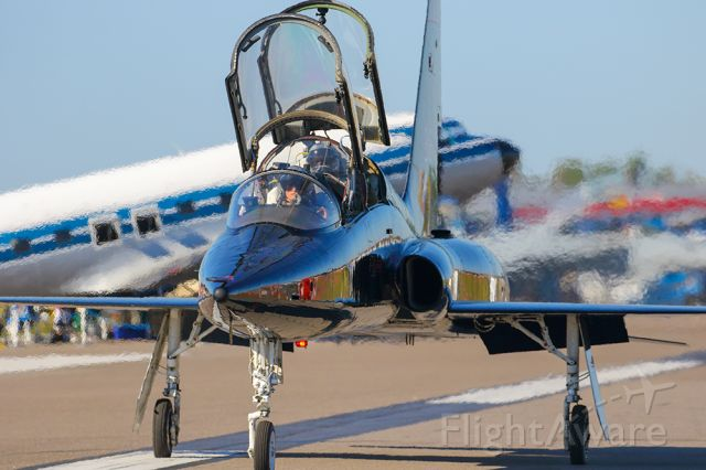 Northrop T-38 Talon — - T-38 trainer taxiing with a DC-3 in the background.