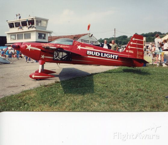 STEPHENS Akro (N10LL) - SUSSEX AIRPORT-SUSSEX, NEW JERSEY, USA-AUGUST 1991: Seen here at Sussex Airport during the world famous Sussex Airshow, is the late Leo Loudenslager Akro Laser 200 aerobatic aircraft. Leo won seven U.S. National Aerobatic titles and one World Aerobatic Championship. He died in a motorcycle accident in 1997. If his schedule permitted, Leo would perform every year at the airshow. This aircraft is now on display at the Smithsonian National Air and Space Museum in Chantilly, VA.