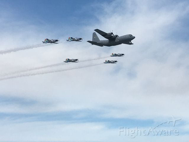 Lockheed C-130 Hercules — - SAAF C-130 in formation with Pilatus PC-7 trainers.br /Armed Forces Day fly-past over Table Bay, Cape Town