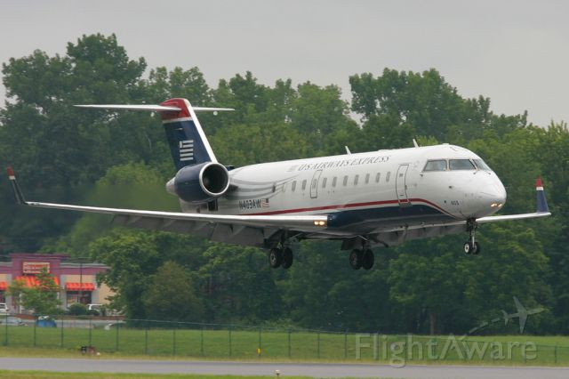 Canadair Regional Jet CRJ-200 (N403AW) - Passing by the Dunkin Donuts drive through