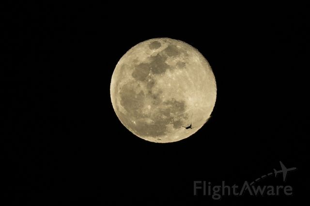 — — - FDX401, MD11, eastbound from LAX to MEM, on March 23, 2016,  the night of the full moon.  Near 8:35PM, taken in Huntington Beach, CA