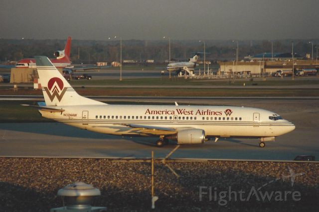 BOEING 737-300 (N324AW) - Notice the three holer eye candy in the back-ground!