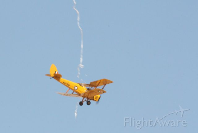 VH-UVZ — - Tiger Moth cutting the ribbon at the opening of the Warbirds Downunder at Temora NSW Australia 2/11/13