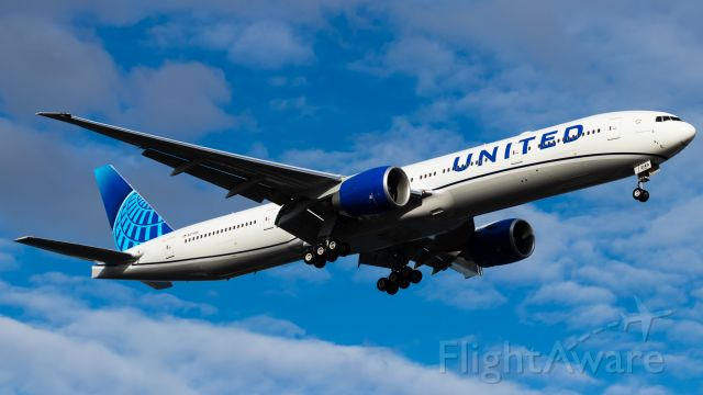 BOEING 777-300 (N2749U) - First United 777 in the new livery. Boeing 769 heavy on a low approach for a touch and go on 10R.