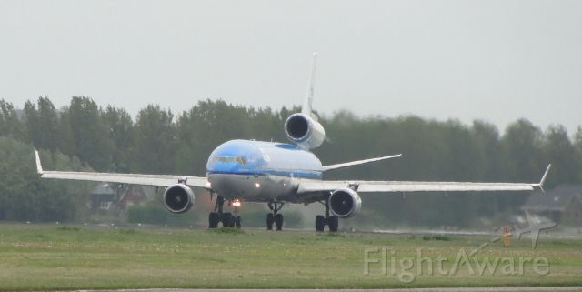 Boeing MD-11 (PH-KCD) - KLM MD-11 short before take off at Schiphol, Amsterdam.