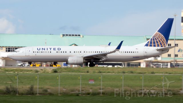 Boeing 737-900 (N68802) - Departing on Runway 29!
