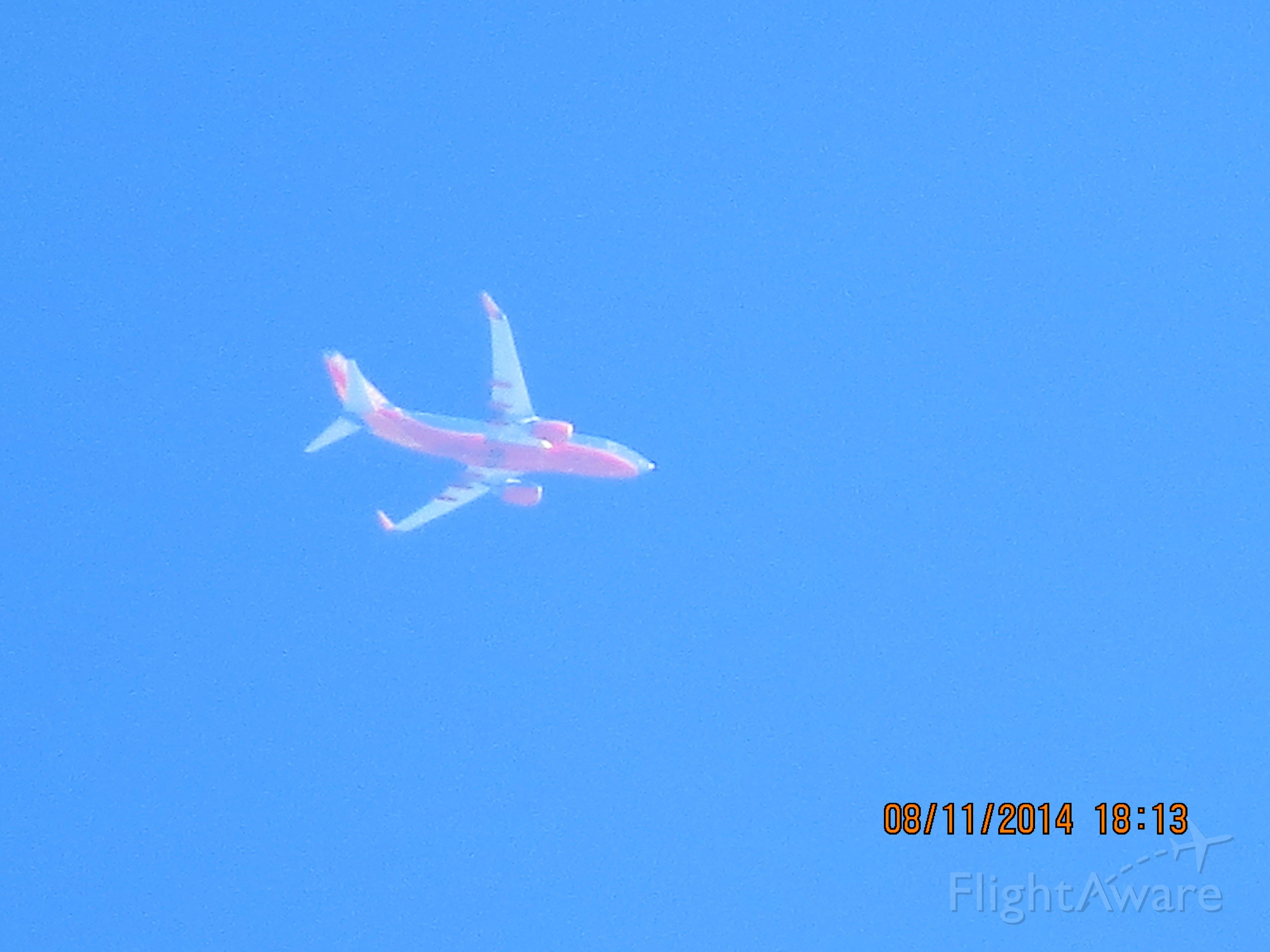Boeing 737-700 (N261WN) - SWA flight 740 from MDW to OKC over Baxter Springs Ks at 36k feet.