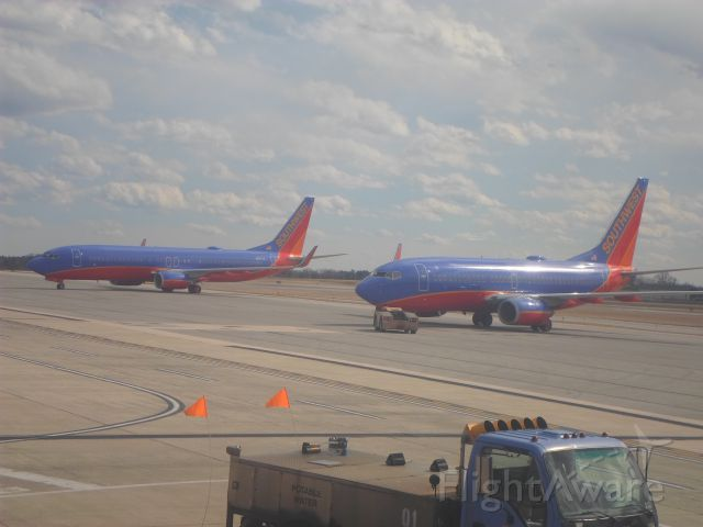Boeing 737-700 (N789SW) - Two Southwest Airlines Boeing 737s await departure from Concourse A at BWI.