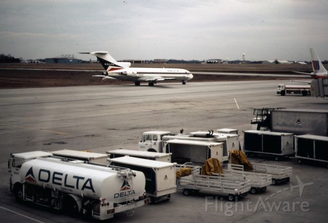 Boeing 727-100 (N520DA) - Delta 727 taxis out with ground equipment in foreground.