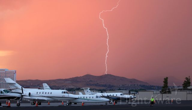 — — - Rain is obscuring the hills north of the airport as a storm moves toward RNO. Shortly after this photo was taken, severe wind sheer at both ends of runways 16R-34L and 16L-34R forced the airport to close for about 30 minutes or so.