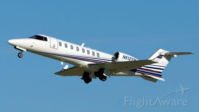 Learjet 45 (N612YM) - 31L departure.