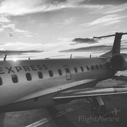 Embraer EMB-145XR (N12167) - United Express flight taken at sunset + converted to black + white / photo taken with an iPhone6s