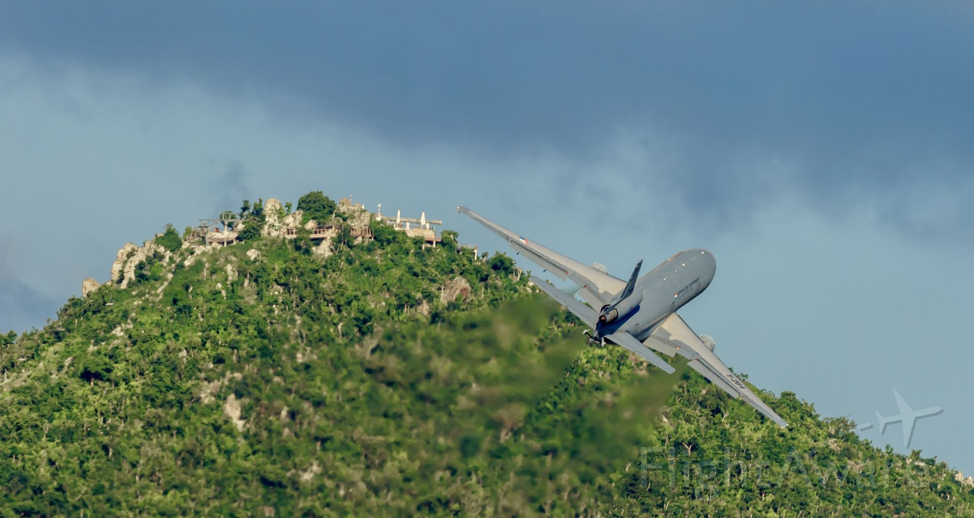 McDonnell Douglas DC-10 (T264) - Royal NLD airforce DC10 departing TNCM St Maarten for the very last time climbing the hills to Holland.