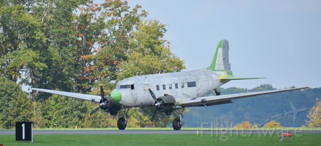 Experimental 100kts-200kts (N34DF) - This photo of the Beach City Baby (N34DF) was taken by me as it landed at the Venango Regional Airport (KFKL) in Franklin, PA 16323 on Saturday afternoon, Oct. 6, 2018, about 1:00 PM.  The Beach City Baby is a partially restored 1942 Douglas DC-3 and it will be hangered at the airport for the foreseeable future. <br /><br />Bill Pixley