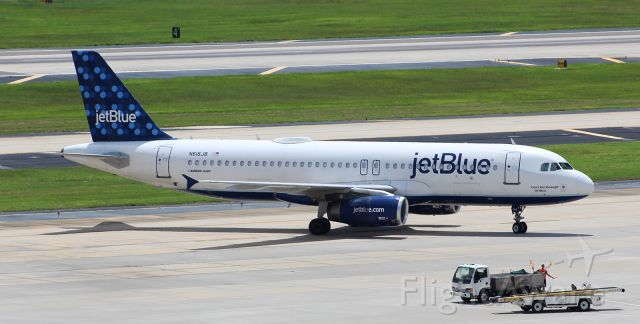 """Airbus A320 (N618JB) - jetBlue Airbus A320 being marshalled into a gate after maintenance at the local MRO. This aircraft (""""Can"""