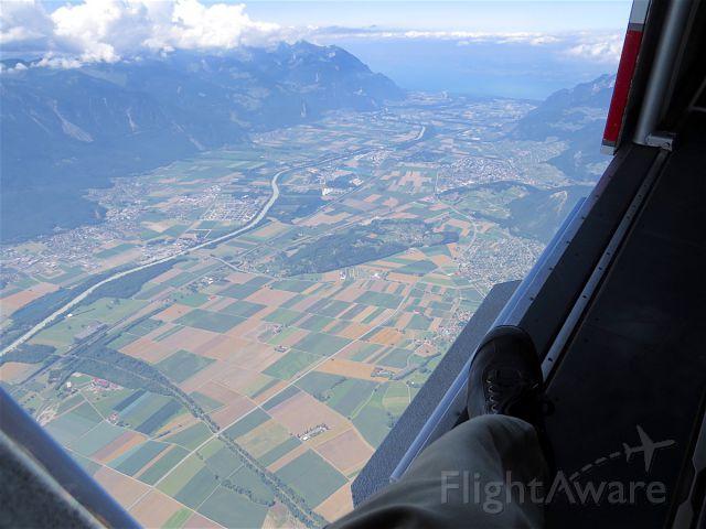 Pilatus PC-6B Turbo-Porter (HB-FLI) - Open door of the PC-6 Pilatus Porter looking down at the Rhone Valley