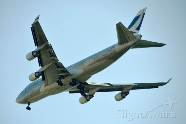Boeing 747-400 (B-HKJ) - Shot from my hotel room.